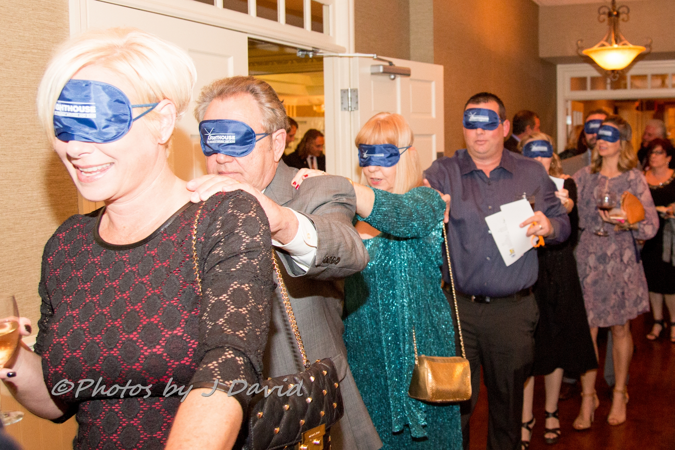 Diners enter in the dark wearing blindfolds